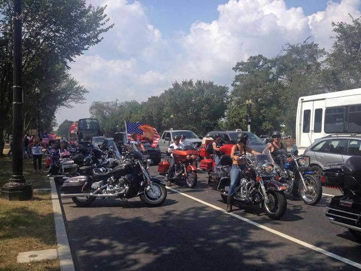 Bikers stuck in slow traffic
